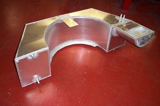 The aluminium fuel tank was custom fabricated shown here waiting to be installed.